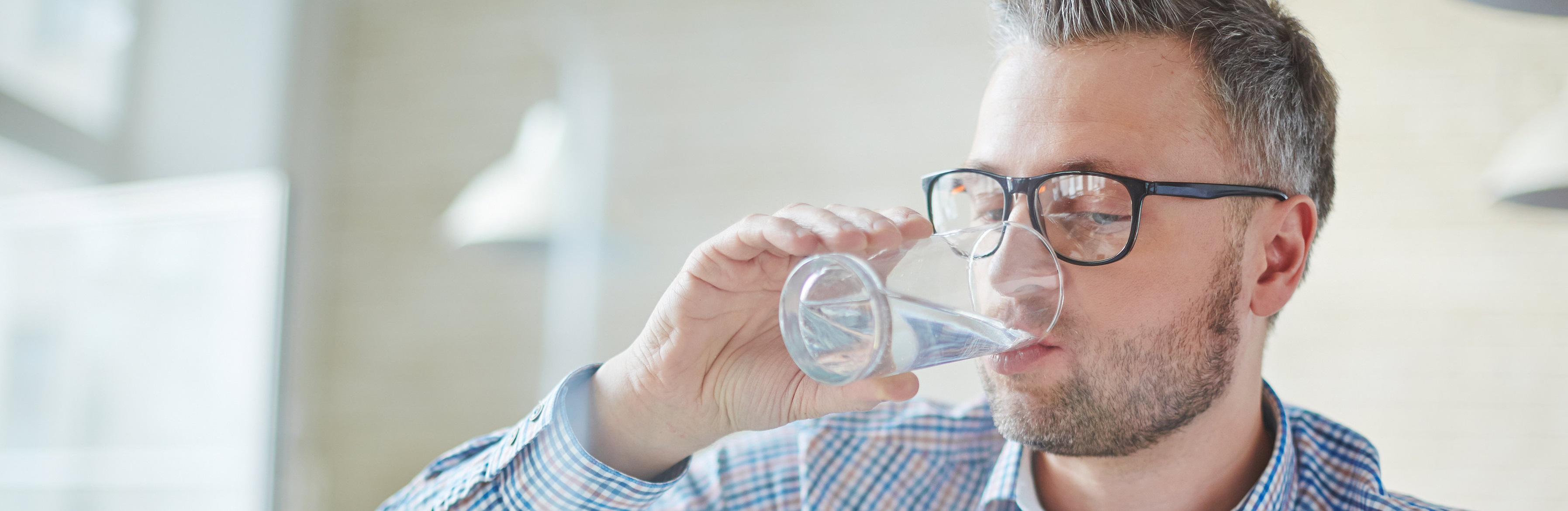 man drinking water hydration